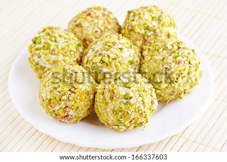 Cheese balls with grapes inside - stock photo