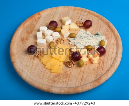 cheese board with delicous cheeses - stock photo