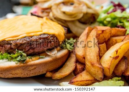 Cheese burger - American cheese burger with fresh salad  - stock photo