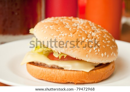 Cheese burger in white plate, shallow depth of field - stock photo