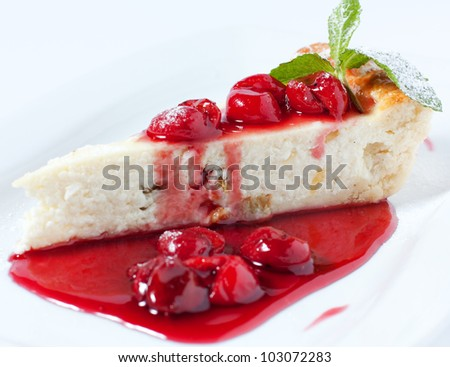 Cheese cake. A delicious dessert with cherry jam - stock photo