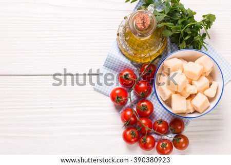 cheese , cherry tomatoes,oil and fresh parsley- ingredients for  salad - stock photo