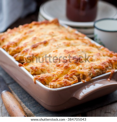 Cheese Crusted Crepe Bake, close up, square - stock photo
