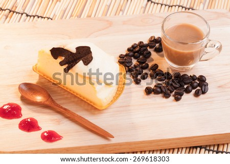 cheese custard cake and cup of coffee on wood. - stock photo