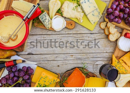 Cheese - different types of cheese on a wooden background - stock photo
