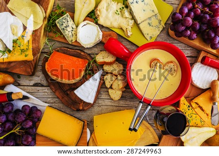 Cheese -  foundue on a wooden table, different types of cheese  - stock photo