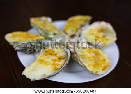 Cheese grilled oyster on dish - stock photo