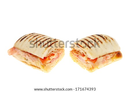 Cheese ham and tomato panini cut into two halves isolated against white - stock photo