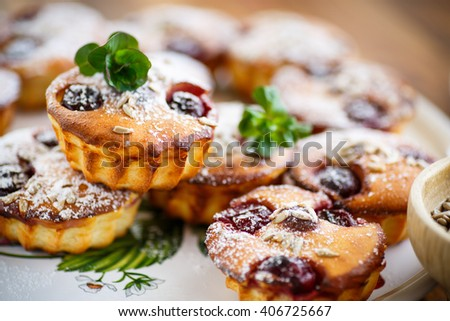 cheese muffins with walnuts and cherries  - stock photo