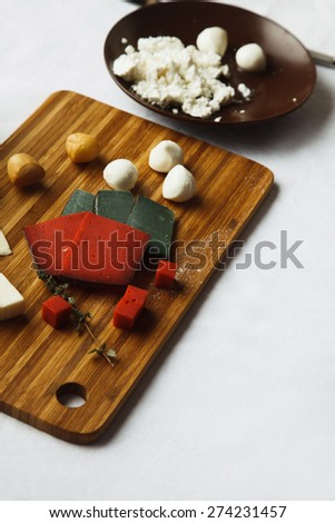 cheese on a table - stock photo