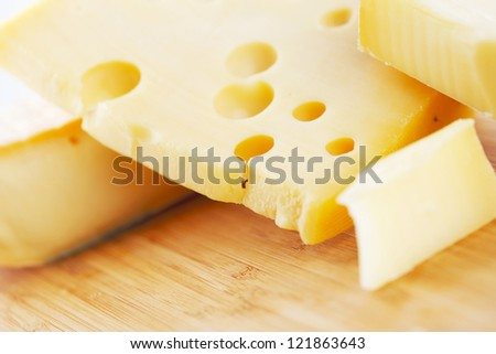 cheese on a wooden table - stock photo