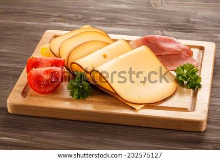 Cheese on cutting board - stock photo