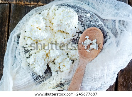 cheese on plate and on a table - stock photo