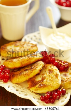 Cheese pancake with sour cream and red currant - stock photo
