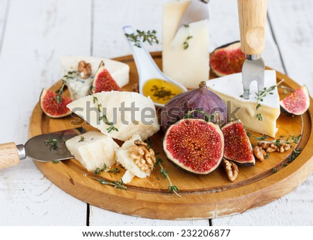 Cheese plate with Fig - stock photo
