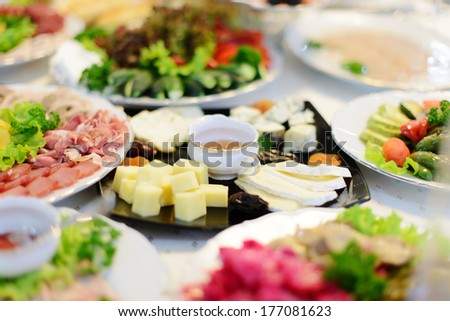 cheese platter on black plate - stock photo
