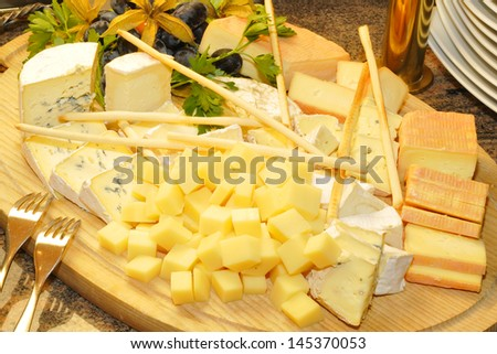 Cheese platter with different varieties. - stock photo
