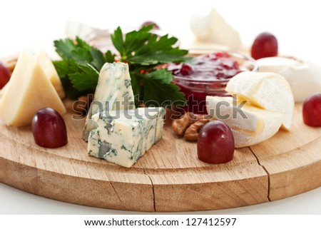 Cheese Platter with Grapes and Sweet Sauce - stock photo