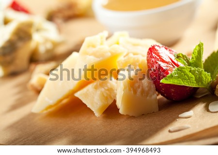 Cheese Platter with Honey Dip and Strawberries - stock photo