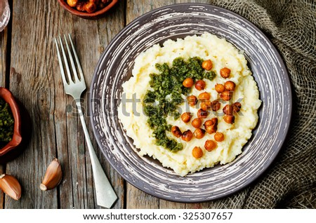 cheese polenta with Basil nuts pesto and roasted spicy chickpeas. toning. selective focus - stock photo