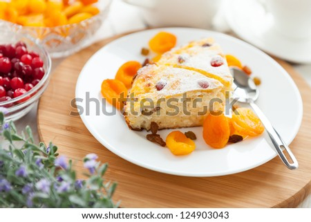 Cheese pudding with dried apricot and raisins close-up on a plate. Tasty dessert - stock photo