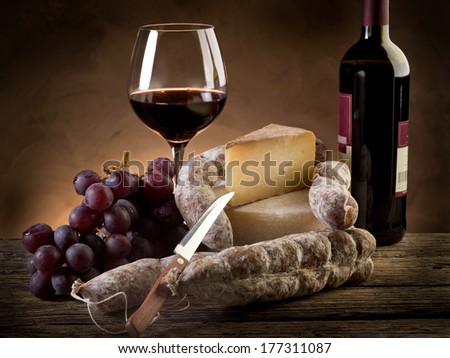 cheese salami grapes and red wine - stock photo