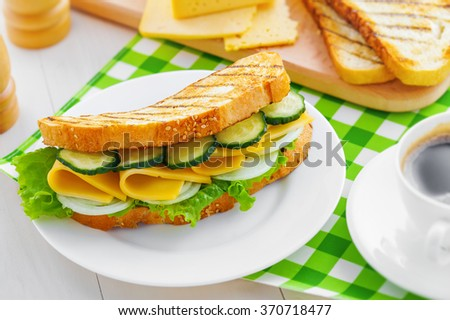 Cheese sandwich on a plate, breakfast with coffee - stock photo