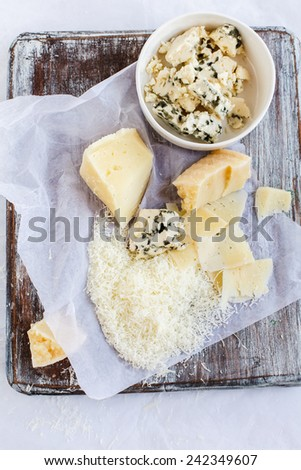 Cheese variety. Food background. Fresh ingredients on a wooden table   - stock photo