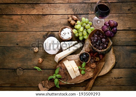 Cheese variety. Food background.  Fresh ingredients on wood - stock photo