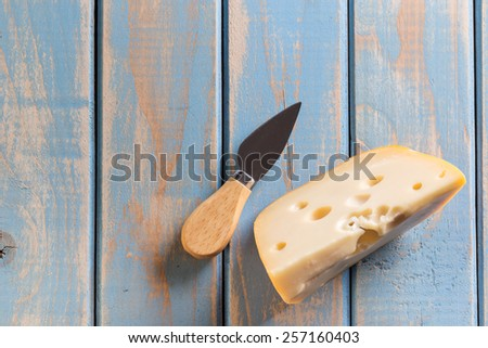 Cheese with cheese knife - stock photo