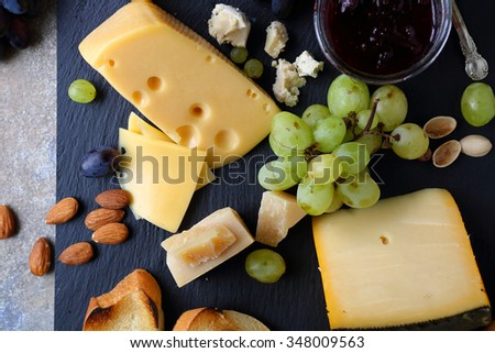 cheese with grapes, food top view - stock photo