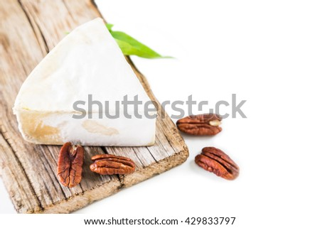 Cheese with white mold and pecan nut on a white background - stock photo