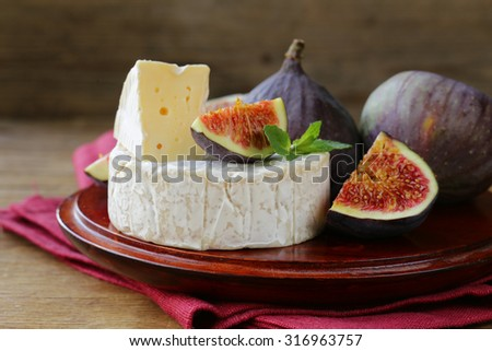 Cheese with white mold (Camembert, Brie) with fresh figs - stock photo