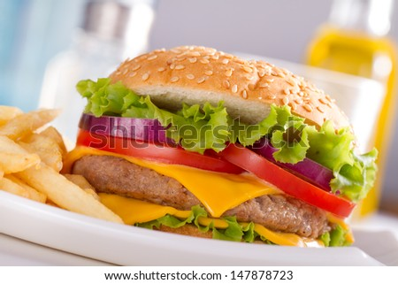 Cheeseburger. Cheeseburger on light background. Vintage Cheeseburger. Home made burger. Fastfood meal. Pub burger. Delicious burger. Gourmet Cheeseburger. Cheeseburger isolated. Rustic Cheeseburger. - stock photo