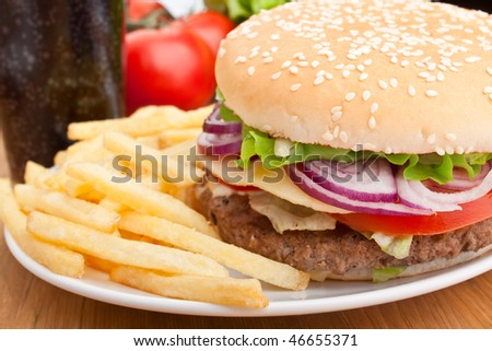 cheeseburger, french fries and cola - stock photo