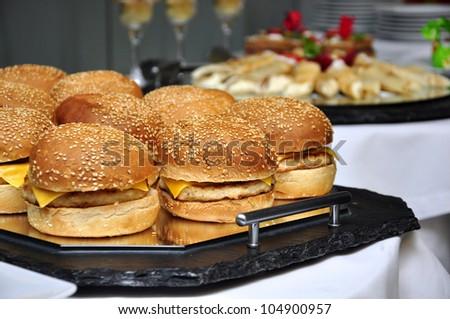 cheeseburgers on a tray, sallow dof. - stock photo