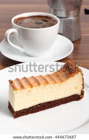Cheesecake and coffee cup. Macro. - stock photo