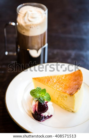 Cheesecake and Coffee Latte on the table - stock photo