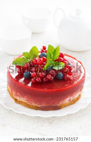 cheesecake with berry jelly on a plate, vertical, close-up - stock photo
