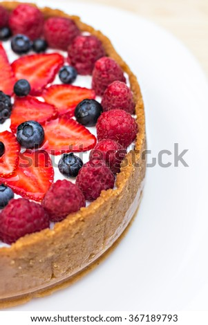 Cheesecake with fresh berries o the table - stock photo