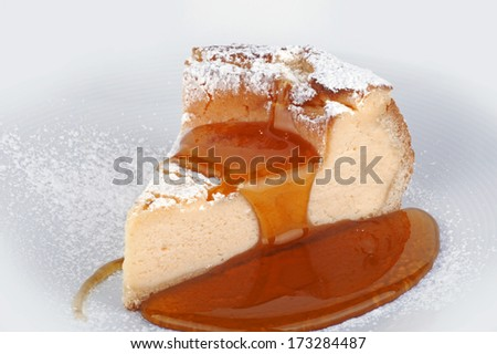 Cheesecake with maple syrup - a slice of cheesecake on the plate - stock photo