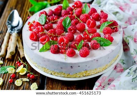 Cheesecake with raspberries - stock photo