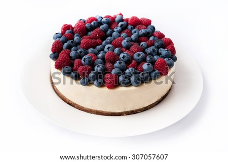 cheesecake with raspberries and blueberries - stock photo