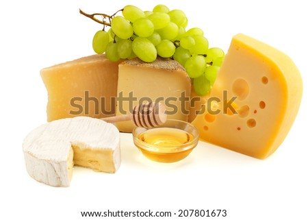 cheeses, grape and honey isolated on white background - stock photo