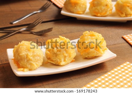 Cheesy bacon potato bites - stock photo