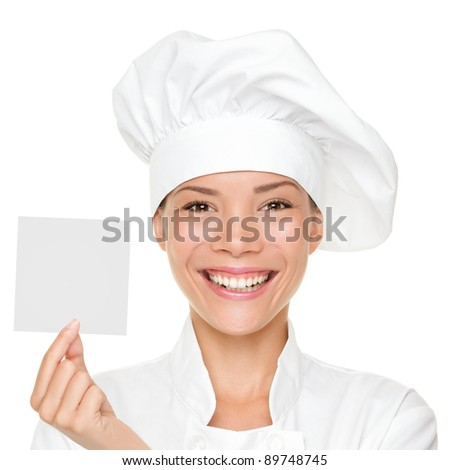 Chef, baker or cook woman showing blank sign card wearing chefs uniform and hat. Blank card for menu, gift card, offer etc Beautiful multicultural Asian / Caucasian female isolated on white background - stock photo