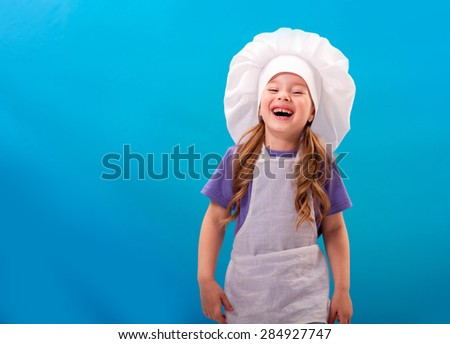 chef child laughs out loud - stock photo
