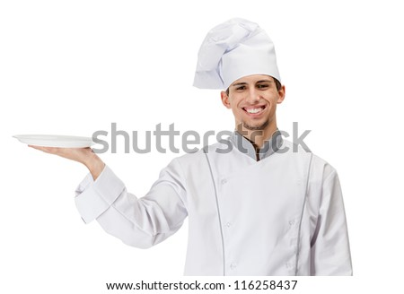 Chef cook in uniform handing a white plate, isolated on white - stock photo