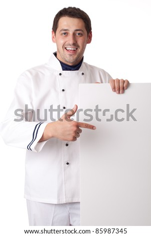 Chef cook showing at blank board. Isolated over white. - stock photo