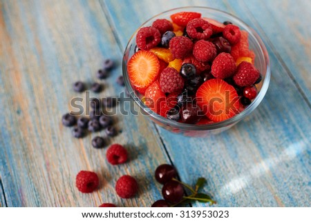 Chef cooked fresh dessert snack after a hearty main dish, cook stylish and simple salad served in a deep glass bowl a few people - stock photo